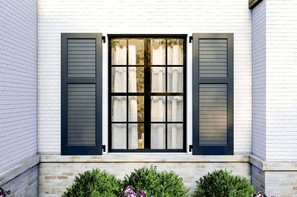 Adorned Openings 40/60 louver shutters on white brick home crafted from composite wood material